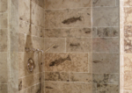 honed fossil stone tile shower 3